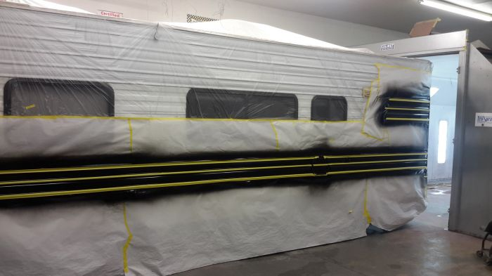 Fifth wheel being prepped for auto paint by Coyote Custom and Collision Repair