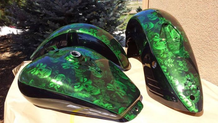 Custom painted motorcycle body parts by Coyote Custom and Collision Repair