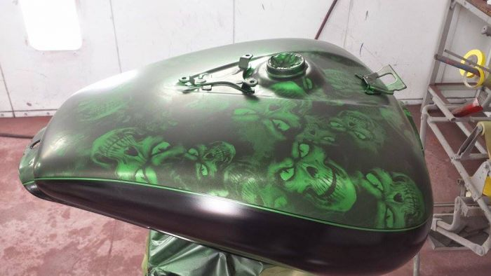 Custom green skull painted gas can for motorcycles by Coyote Customs and Collision repair